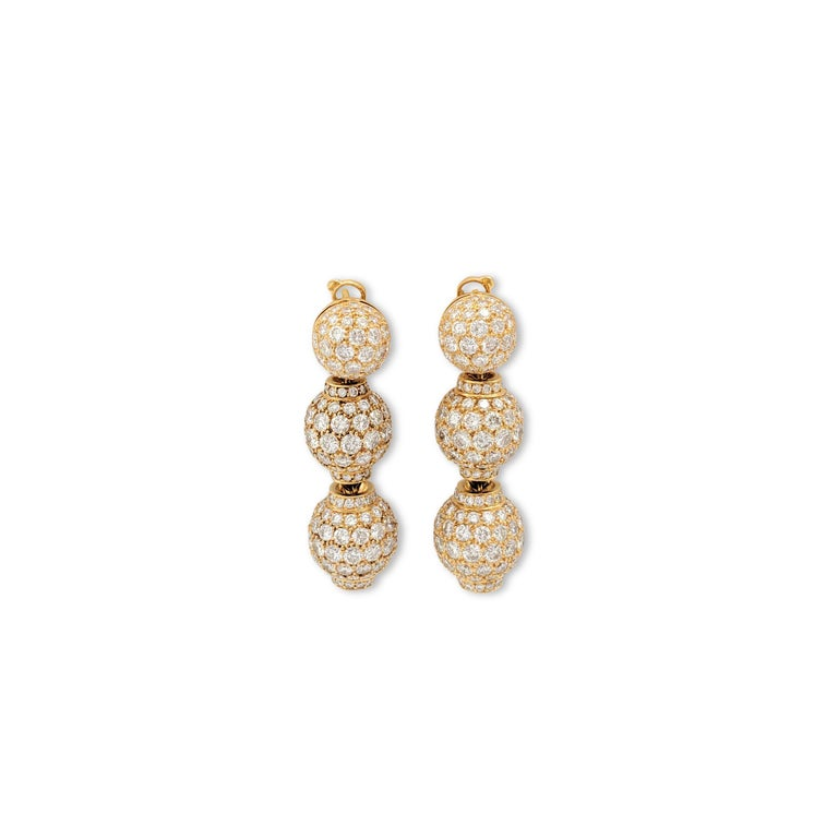Authentic elegant Boucheron drop earrings crafted in 18 karat yellow gold center on three round stations set with an estimated 15.00 carats of gleaming round brilliant cut diamonds (E-F, VS). Signed Boucheron, OR 750, with serial number and