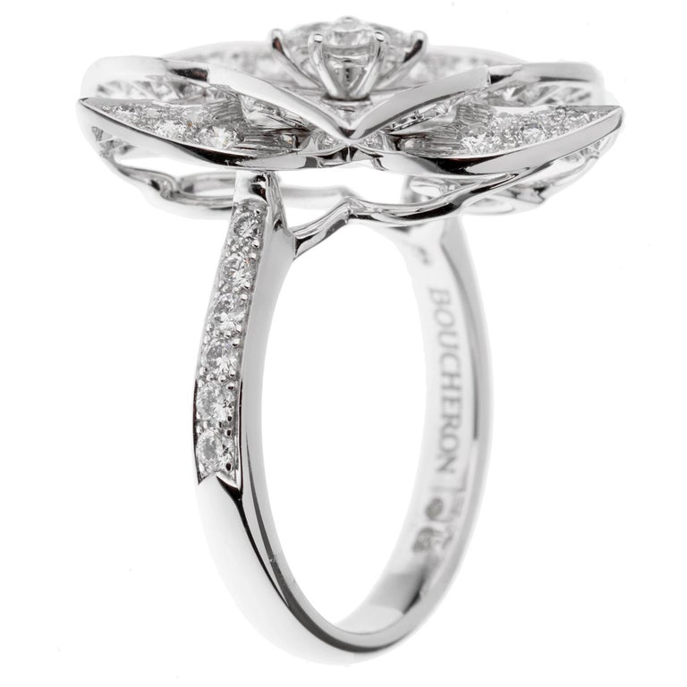 A chic Boucheron diamond ring showcasing a flower motif in shimmering 18k white gold, the ring is set with 1.55ct of the finest round brilliant cut vs diamonds. Size 6 1/4 and can be resized.  Sku: 3094