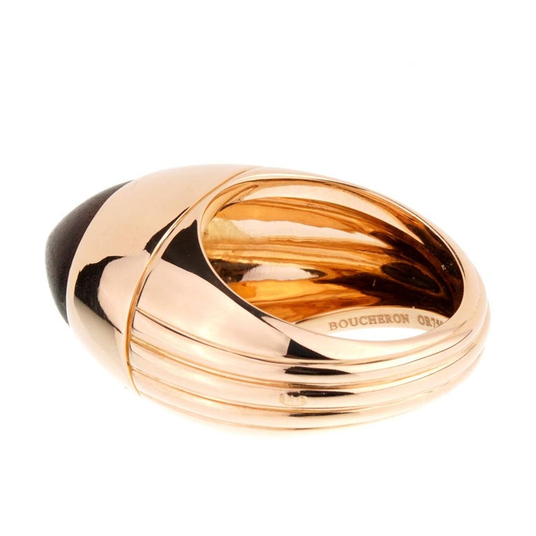 The production of this chic limited edition rose gold wood ring from Boucheron was limited to 26 pieces. The centerpiece is oval wood stone surrounded by a wide, oval 18kt rose gold band.  Size 5 1/2, Width: .55