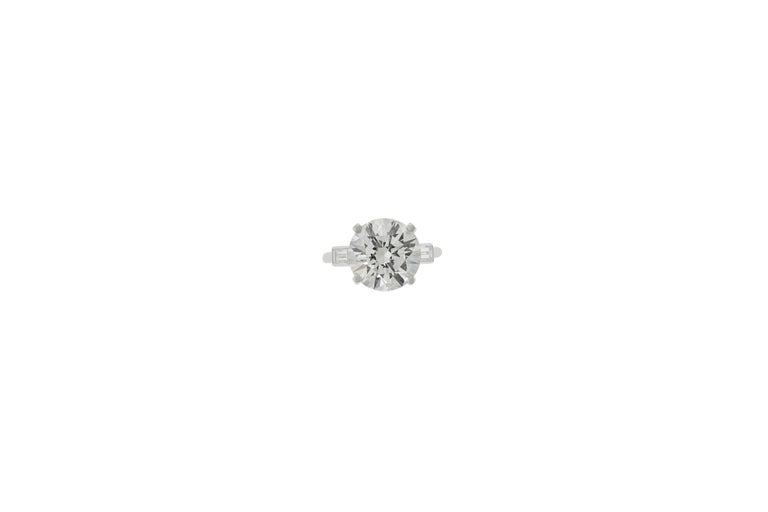 4.76 carat round brilliant cut diamond engagement ring flanked on either side by a baguette cut stone. Signed Boucheron Paris. Size 6. GIA certificate No. 2165796208 F VS2.    Viewings available in our NYC showroom by appointment.