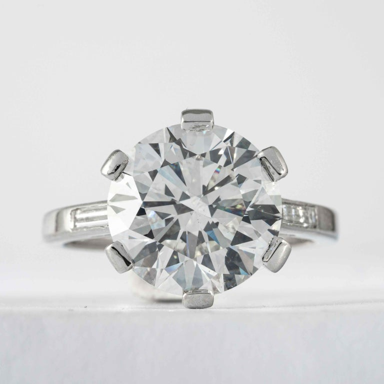 This diamond ring is being offered by Shreve, Crump & Low.  This 5.69 carat GIA Certified I VS2 round brilliant cut triple excellent diamond measuring 11.39 - 11.42 x 7.01 mm is custom set in a chic and romantically classic platinum and diamond