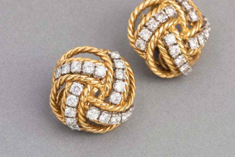 Boucheron Paris Gold and Diamonds Earrings  Wonderful pair of clip earrings, made by Boucheron Paris circa 1960.   The diamonds weight 1.60 +carats for each earring.    The design is very elegant, the diamonds are high quality. It stands very well