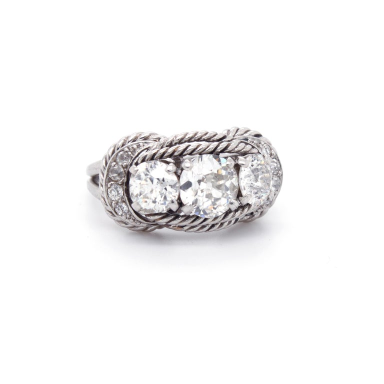 Old Mine Cut Boucheron Retro Three-Stone Diamond Ring, circa 1940s For Sale