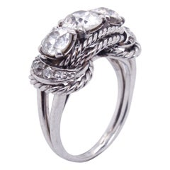 Boucheron Retro Three-Stone Diamond Ring, circa 1940s