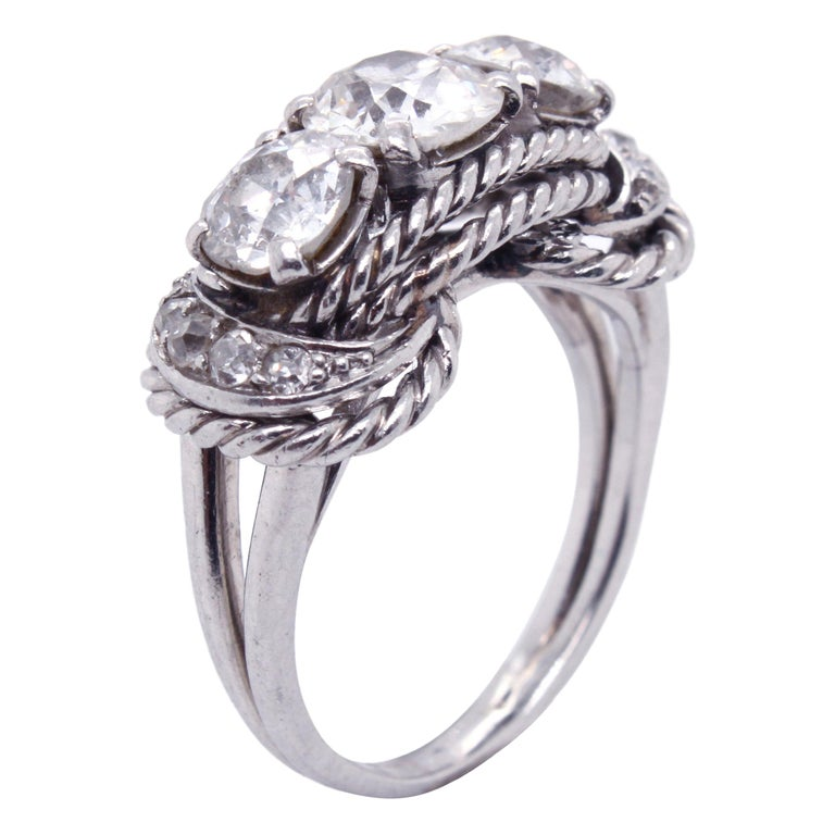 Boucheron Retro Three-Stone Diamond Ring, circa 1940s For Sale