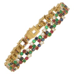 Boucheron Ruby, Emerald, Sapphire and Diamond Bracelet Set in 18 Karat Gold