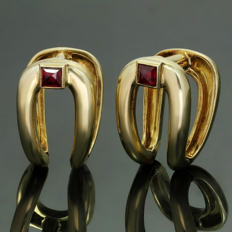 These classic retro Boucheron cufflinks are crafted in 18k yellow gold and bezel-set with French-cut square red rubies. Made in France circa 1940s. Measurements: 0.55
