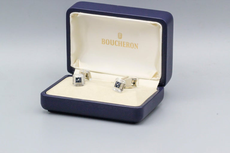 Handsome sapphire, rock crystal and 18K yellow gold cufflinks by Boucheron.   Hallmarks: Boucheron, maker's mark, OR 750, reference numbers, French 18K gold assay marks.