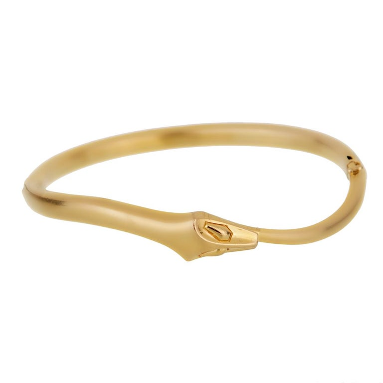 A fabulous vintage Boucheron snake hinged bangle in 18karat yellow gold, designed as a snake seamlessly coiling around the wrist.