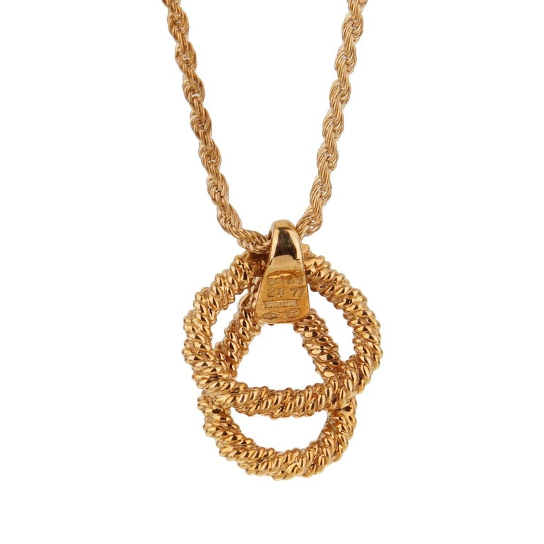 A magnificent Boucheron diamond pendant necklace featuring 3 round brilliant cut diamonds set in 18k yellow gold. The necklace is accompanied with a rope necklace by Boucheron.  Necklace length 17