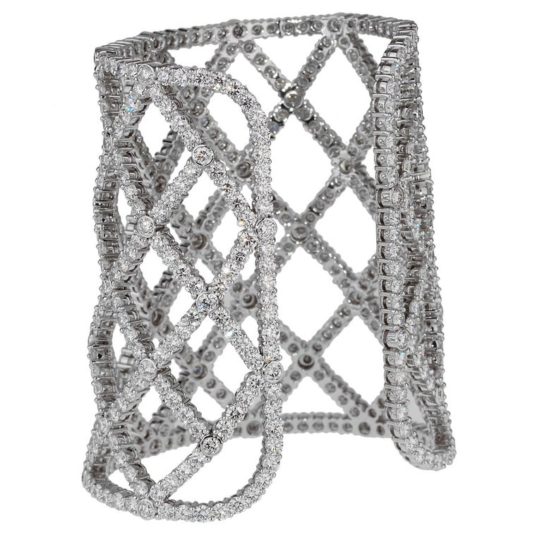 A magnificent Boucheron cuff bracelet boasting 65cts of the finest diamonds set in 18k white gold. The diamonds are graded VS quality and better and the bracelet has a weight of 152.8 grams.  The cuff has a width of 3.25