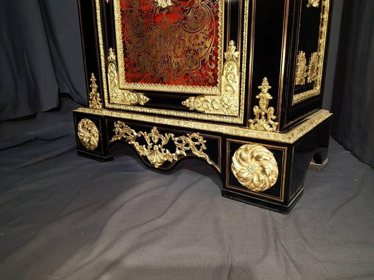 Rare and imposing cabinet  in Boulle Marquetry, France end of 18th Century circa 1780. Impressive ornementation in gilt bronze with acanthus  gold leaves , mascarons etc   Marquetry of red horn and brass with Gorgeous decorations and caracthers. In