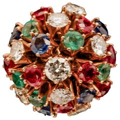 A Cluster Style  Cocktail Ring with Diamonds, Rubies, Emeralds and Sapphires