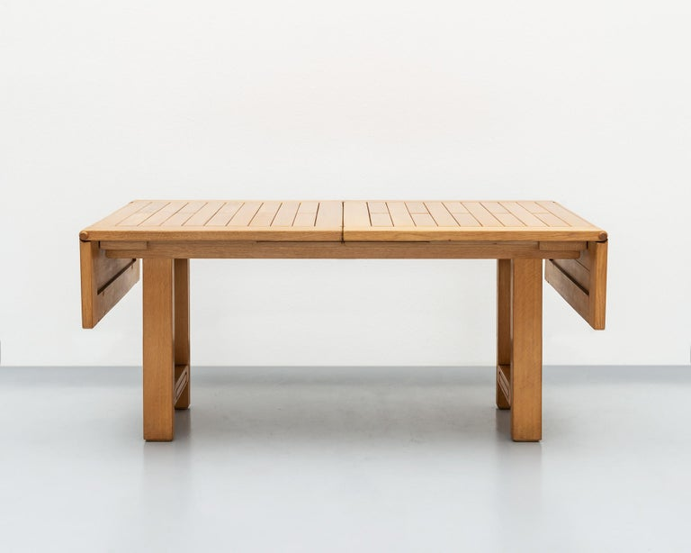 A beautiful example of the work of Guillerme et Chambron in golden oak. This table has drop leaves and comes with one extra leaf (see last two images), which extends the length to 97.5