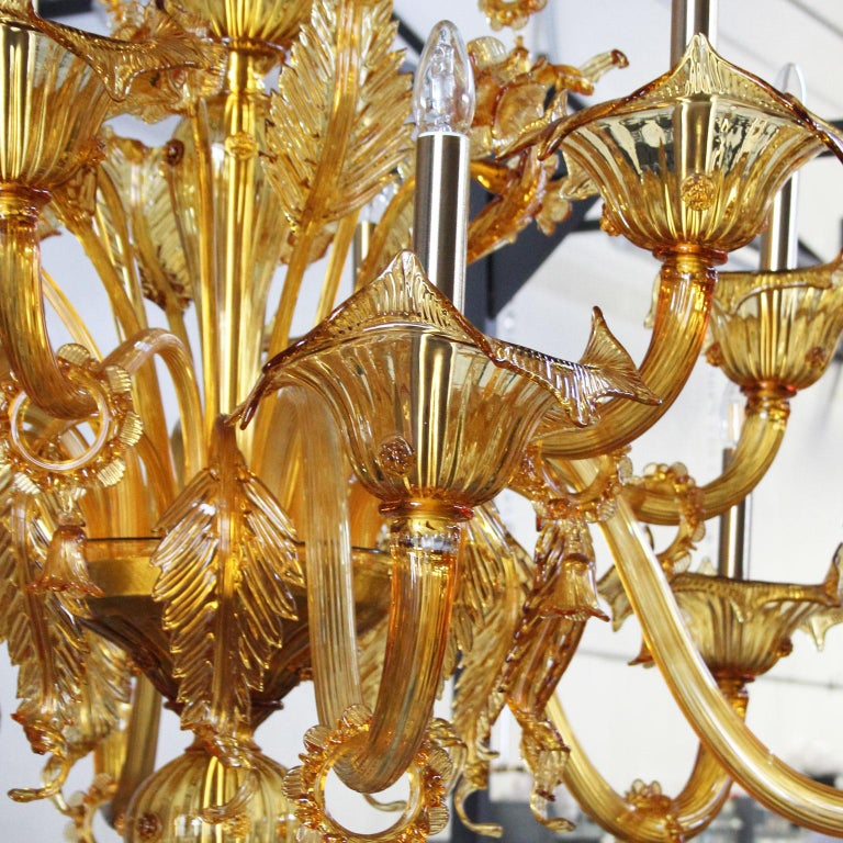Multiforme Bovary chandelier, 42 lights, three tiers, Amber Murano glass  Bovary: a collection of handmade blown glass chandeliers and lamps which takes inspiration from the Classic floral Venetian chandeliers. The Bovary collection conferes to