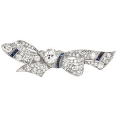 Bow Tie Platinum with Diamonds and Synthetic Sapphire Brooch