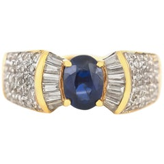 Bow Tie Style with Center Sapphire and Diamonds Around Ring