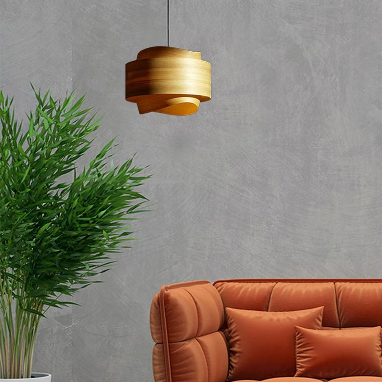 This large cypress wood drum light, BOWEN, is a Mid-Century Modern style pendant. Designers use a chandelier for alcove, entryway, dining room or conference room. BOWEN is a customizable shade offered in several wood types. BOWEN gives a warm light,