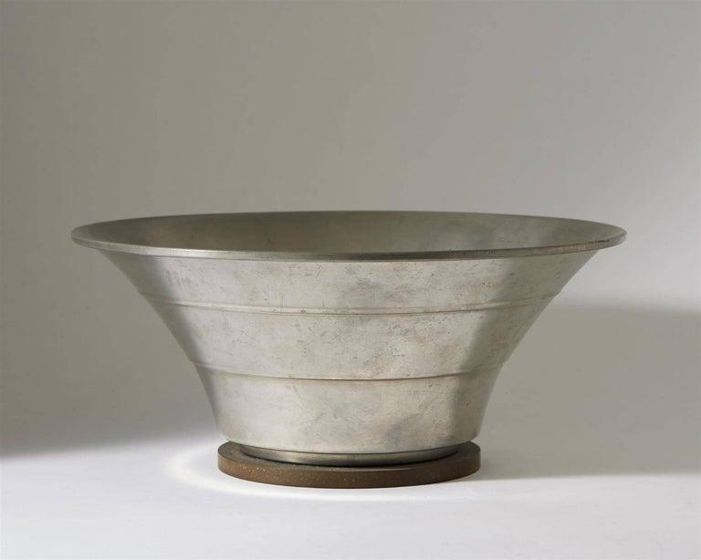 Bowl designed by Hugo Gelia for Ystad Metall,  Sweden, 1941.  Pewter and bakalite.  Measure: H 11.5 cm/ 4 1/2'' D 25 cm/ 10''.