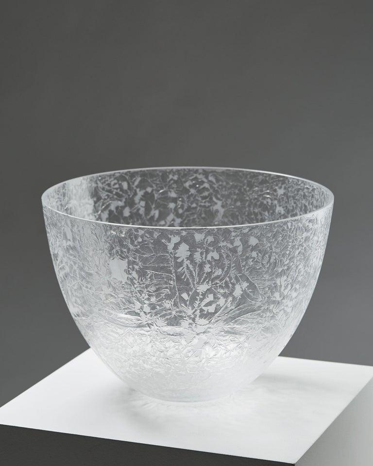 Bowl designed by Ingegerd Råman for Orrefors,  Sweden, 2000s.   Glass.