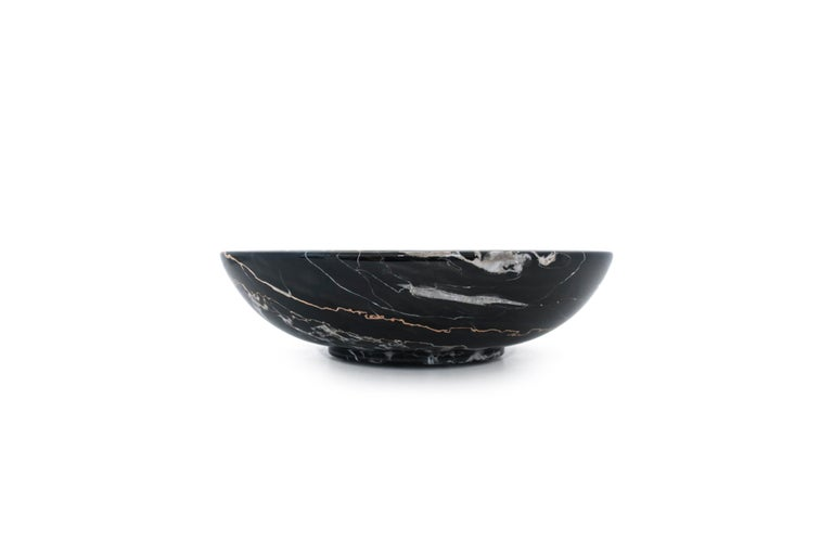 Bowl in Portoro marble, characterised by a dark black background with golden veins. Processed in Carrara, Italy. You have a 100% made in Italy product. It is ideal to present fruit or to be used as a centrepiece. Each piece is in a way unique (every
