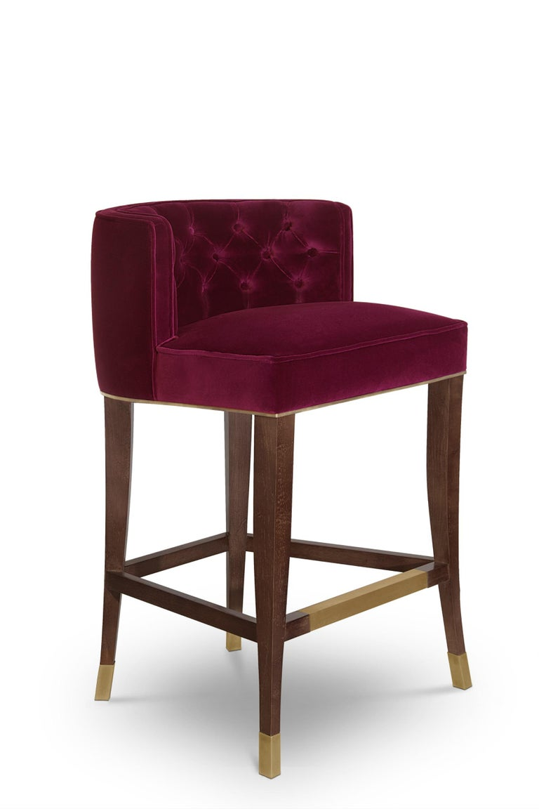 With origins in France, the House of Bourbon was a dynasty known for its class and luxury. Bourbon counter stool embodies this opulence through its button-tufted inner back, rich cotton velvet and legs in ash with walnut stain matte varnish. This