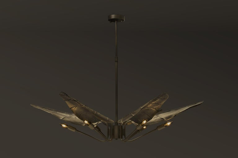 With origins in South Africa, Calla lily flower is one of the most graceful things nature has conceived. Inspired by its delicacy, our design team created Calla suspension light. With a graceful aged brass top in the shape of elegant leafs, the