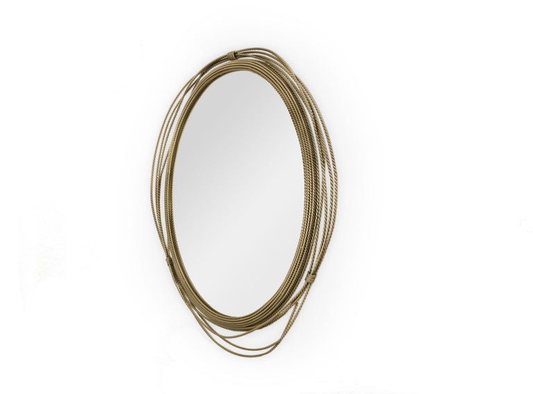 Kayan women are known for using neck rings with the intention of lengthening their necks. All the way from Myanmar, KAYAN Round Mirror is made of a unique aged brushed brass structure. This decorative mirror will surely spice up a boring wall. Aged