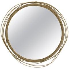 Kayan Mirror in Aged Brushed Brass
