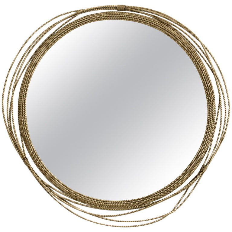 Kayan Mirror in Aged Brushed Brass For Sale