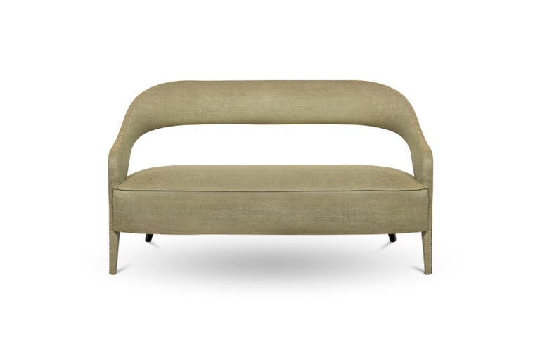 In Roman mythology, Tellus is the goddess of the Earth. TELLUS Sofa honors its deity aura. The twill fabric, nailhead trim and the back legs in matte lacquered add subtle sophistication, making this fabric sofa an elegant piece able to fit in any