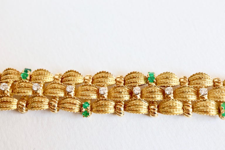 Brilliant Cut Bracelet circa 1960 Articulated in 18 Karat Yellow Gold Diamonds and Emeralds For Sale