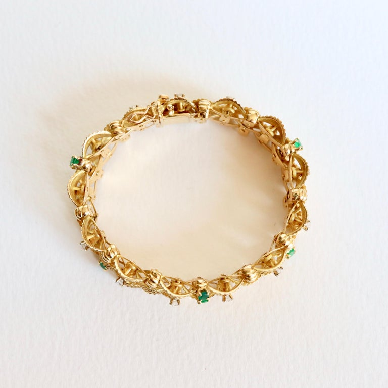 Women's Bracelet circa 1960 Articulated in 18 Karat Yellow Gold Diamonds and Emeralds For Sale
