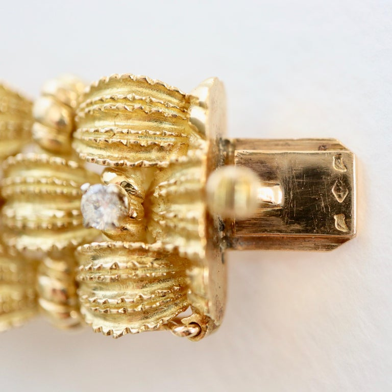 Bracelet circa 1960 Articulated in 18 Karat Yellow Gold Diamonds and Emeralds For Sale 1