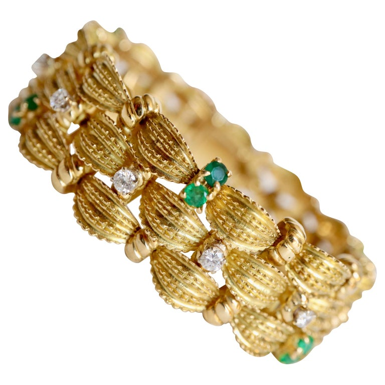 Bracelet circa 1960 Articulated in 18 Karat Yellow Gold Diamonds and Emeralds For Sale