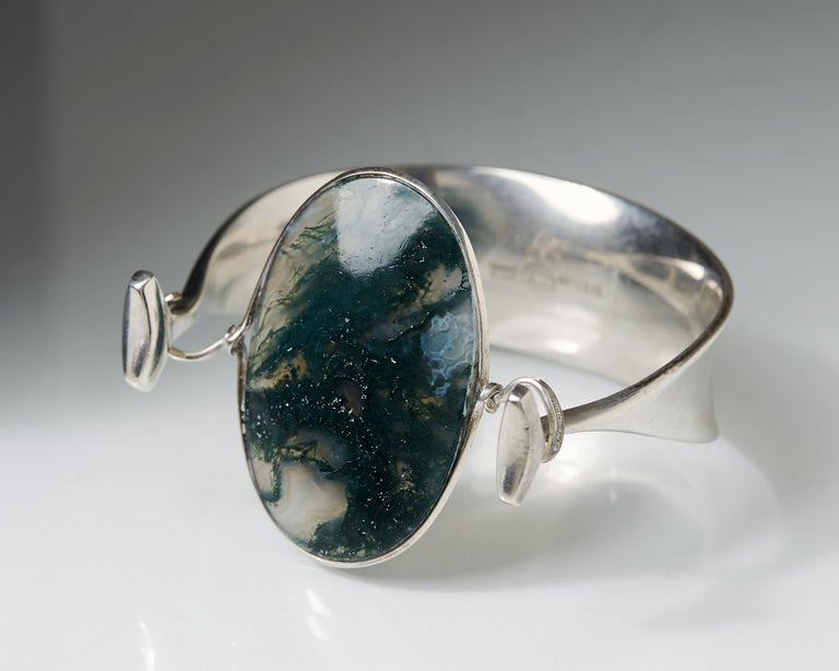 Sterling silver and moss agate.