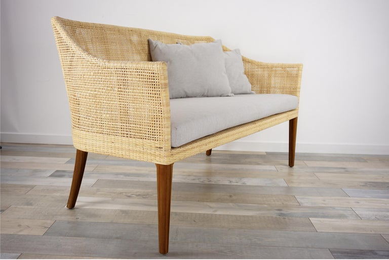 Elegant rattan sofa with wooden structure combining quality, robustness and class. Comfortable and ergonomic, aerial and poetic. The armrests height is 60cm and the seat height with cushion is 42cm ( 35cm without ) All the cushions are include . In