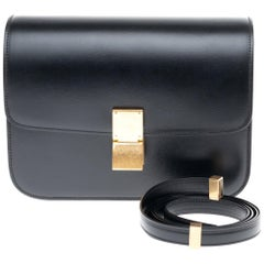 Brand New Céline Classic handbag with strap in black calfskin and gold hardware