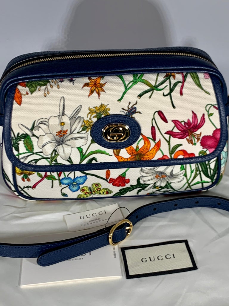 Flora Small  leather-trimmed printed canvas tote Latest and Hot  Brand new Gucci Flora small sized handbag. With an off white canvas with a bright colorful floral pattern. The tote features Blue  leather at the base, trim, and Have  leather shoulder