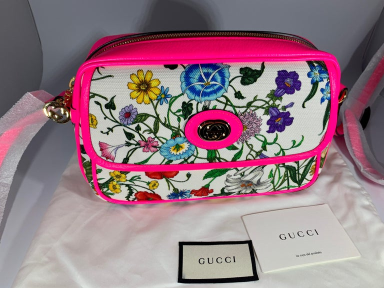 Flora Small  leather-trimmed printed canvas tote Latest and Hot  Brand new Gucci Flora small sized handbag. With an off white canvas with a bright colorful floral pattern. The tote features Pink leather at the base, trim, and Have  leather shoulder