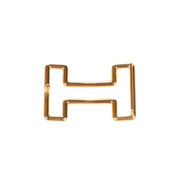 Type: Belt Buckle Marque: Hermès Modèle: Tonight Material : Steel Color : Gold Signature: HERMES  Shape : H For a leather of 3.2 cm. Dimensions : H: 3.7 x L: 6 x P: 1.4 cm Pristine condition - Never worn - Comes with dustbag