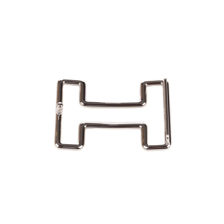 Type: Belt Buckle Marque: Hermès Modèle: Tonight Material : Steel Color : Silvery Signature: HERMES  Shape : H For a leather of 3.2 cm. Dimensions : H: 3.7 x L: 6 x P: 1.4 cm Pristine condition - Never worn - Comes with dustbag