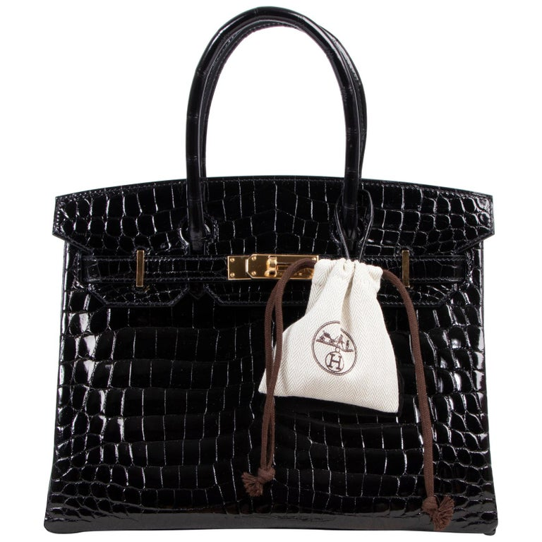 BRAND NEW  Hermès Birkin 30 Crocodile Niloticus Lisse Noir GHW  The real lover of luxury will feel his or her heart beat faster upon seeing this gorgeous Hermès Birkin 30 Crocodile Niloticus Lisse Noir GHW. The shiny black crocodile hide is exotic