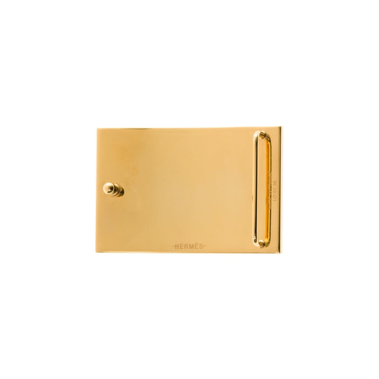 Type: Belt buckle  Brand: Hermès  Material: Striped gold-plated metal Colour: Gold Signed HERMES  Shape: rectangle For 3.2 cm wide leather link (leather link not provided)  Dimensions: H: 3.7 x W: 6 x D: 1.4 cm  Brand new - Sold with original dustbag