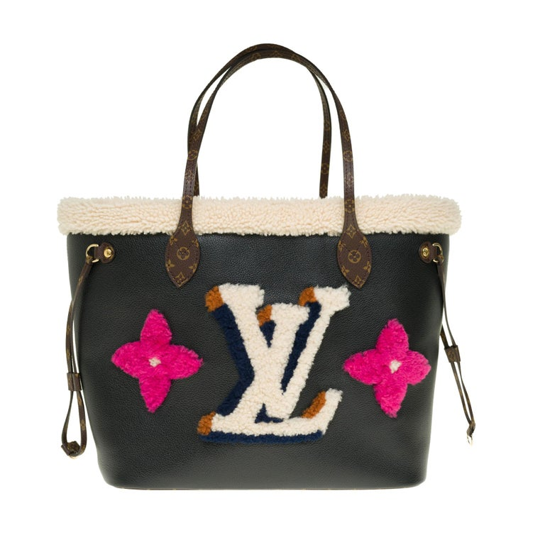 LIMITED EDITION - SOLD OUT!  This Neverfull MM bag features ultra-soft black grained leather and luxurious shearling trim. It is decorated with LV Initials and Monogram flowers created by a shearling patchwork of various colors. Laces on the sides