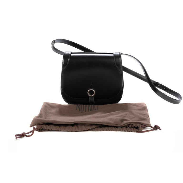 Limited edition. Super rare.  Retail for 2600 Euro. Box Calf leather. As Moynat celebrates its 165th year in creating trunks and bag this year, they have also introduced this new mini bag. The bag includes a detachable shoulder strap, allowing it to