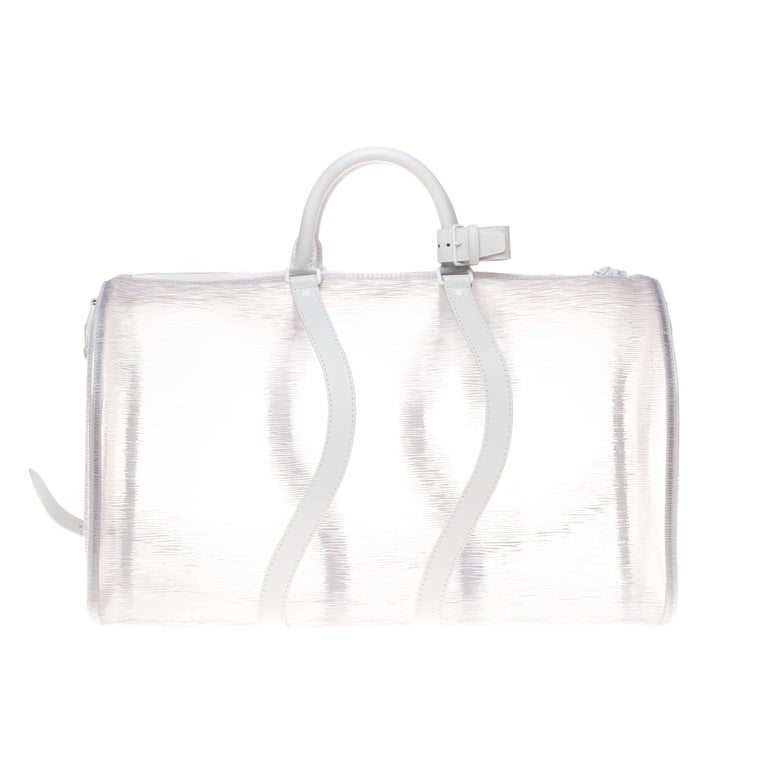 Ultra limited edition by LV:  Virgil Abloh continues to explore innovative materials for the Spring-Summer 2020 pre-collection with this Keepall Shoulder Bag 50 in transparent and durable PVC, embossed with the Epi motif.  To reinvent this iconic