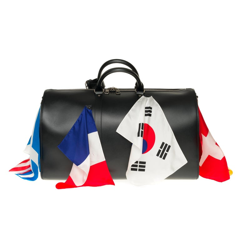 """Ultra exclusive piece from the Fashion show LV 2020 - SOLD OUT  The Keepall Bandoulière 50 is fashioned from calf leather and festooned with flags. For Men's Artistic Director Virgil Abloh, flags are """"the humanitarian pop symbols for our times."""""""