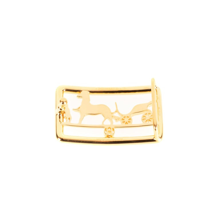Brand new and from the new collection !  Type: Belt Buckle Brand: Hermès Model : Calèche Material : Steel Color : Shiny Gold Signature: Hermès For a leather of 3.2 cm  Dimensions : H: 2,8 x L: 4,8 x P: 1.4 cm Pristine Condition- Sold with dustbag.