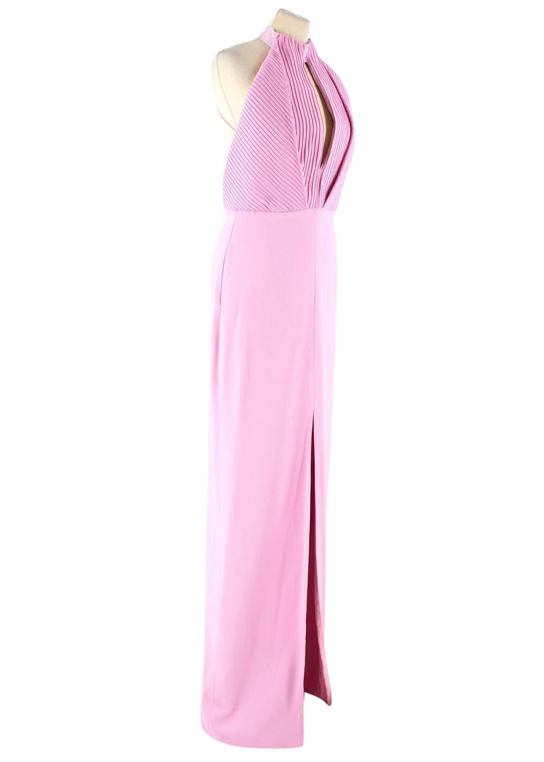 Brandon Maxwell pintuck-bodice crepe gown  -Pink gown with slit -Ribbed bodice with keyhole cut out -Open back -Zip and hook and eye closure -Two front pockets -Please note the belt is not included.  Please note, these items are pre-owned and may